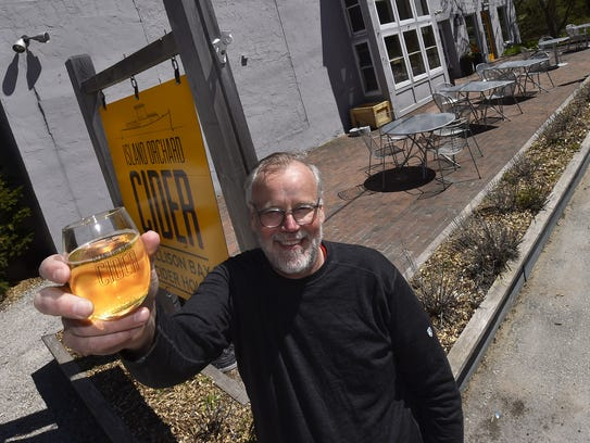 Island Orchard Cider owner Bob Purman toasts the new