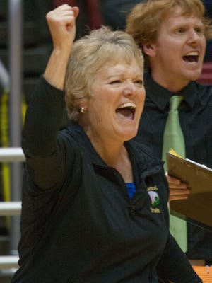 Cathedral Head Coach Jean Kesterson cheers on her team during the state volleyball championship against Carmel at Ball State, Nov. 8, 2014. Carmel won three games to two.