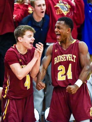 Roosevelt's Tucker Large (4) and Tyler Feldkamp (24) celebrates a basket during their high school basketball game on Dec. 12, 2017 at Washington. Roosevelt beat Washington 63-62.