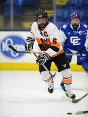 Northville's Jack Sargent (6) jumps up the ice on the