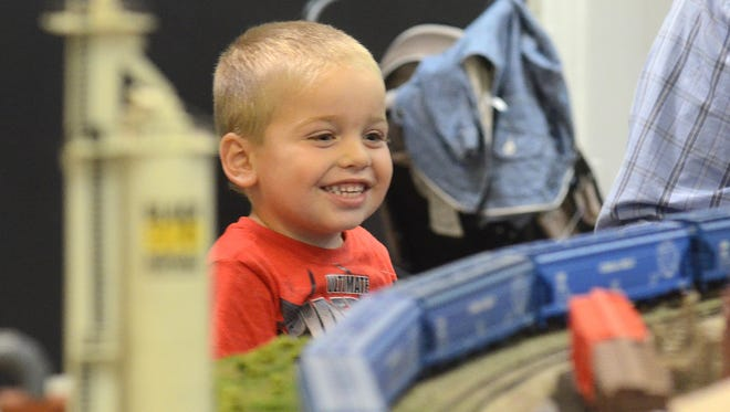 P.J. Cranick, 4, checks out the model trains at the Art Center's display.