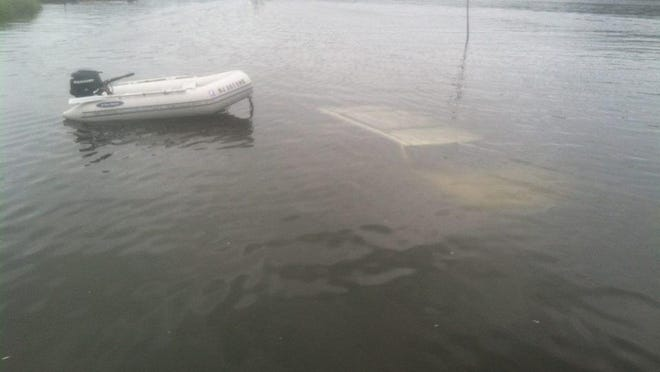 The Rumson Police Department posted this photo on its Facebook page of a submerged car in the Navesink River on Saturday afternoon.