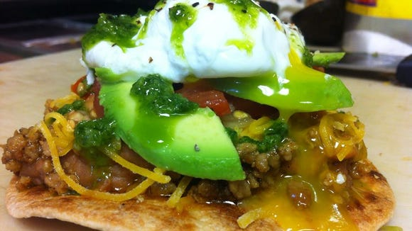 The breakfast Mexican Benedict is pictured at Taco