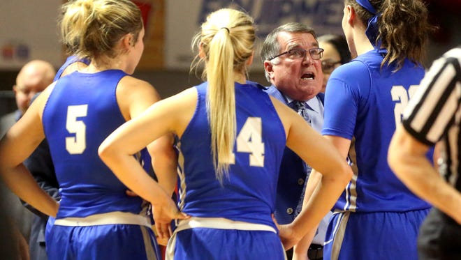 MTSU's head coach Rick Insell talks with players Abbey Sissom (5),Katie Collier (14) and Gabby Lyon (23) during a timeout in the game against Western Kentucky, on Thursday, Jan. 4, 2018, at Western Kentucky University.