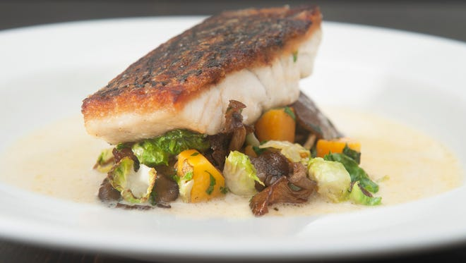 "Baramundi is prepared with oyster mushroom, Brussels leaves, gramma, 'green"" bacon and scallop nage at Two Fish in Haddonfield."
