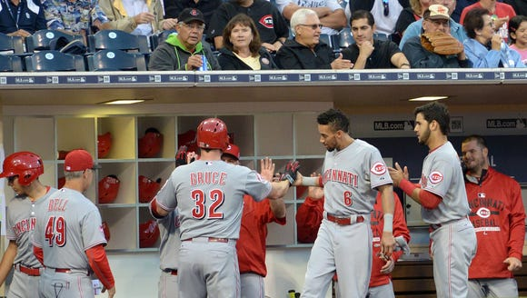 Reds right fielder Jay Bruce is congratulated after