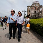 Oliver Stone, left, and PeterKuznick visit in August the Atomic Bomb Dome, a landmark of the aftermath of the 1945 atomic bombing in Hiroshima.
