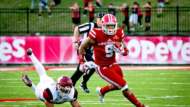 UL running back Trey Ragas runs into the open field during the Cajuns' 47-34 homecoming win over New Mexico State on Saturday.