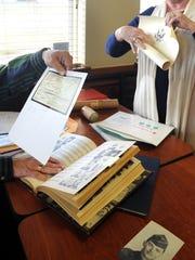 Sharon Densman and James Smith share documents and photos.
