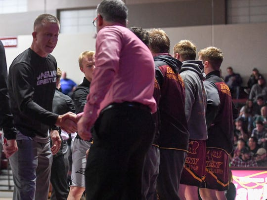 Ankeny Centennial Coach Jay Groth shakes hand with Ankeny Coach Jack Wignall prior to the wrestling match between the Ankeny Hawks and the Centennial Jaguars on Thursday, Jan. 18, 2018 At Ankeny High School.