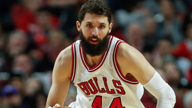 Chicago Bulls forward Nikola Mirotic is ready to leave after being punched by teammate Bobby Portis.