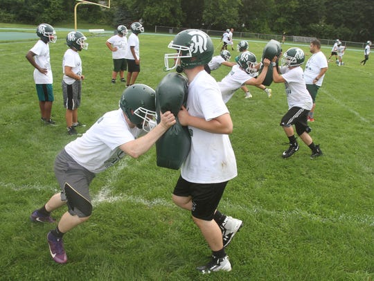Spackenkill football players on a blocking drill during