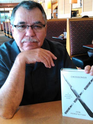 "Jon Kerstetter of Iowa City is a familiar face at Panera Bread at the Iowa City Marketplace, where he wrote ""Crossings"" over a seven-year period. He'll read excerpts this weekend at the Iowa City Book Festival."