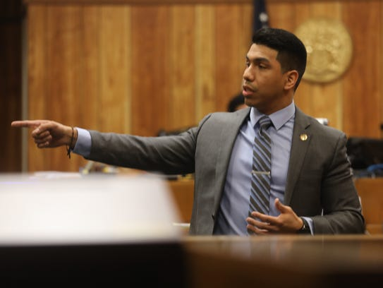Prosecutor Jonathan Barrera points to the defendant,