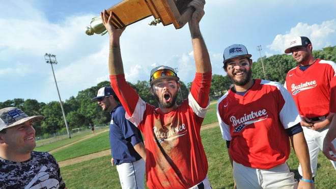 Braintree White Sox outfielder Mike Muir, who grew up in Bridgewater, holds high the Cranberry Baseball League championship trophy as his team celebrates after defeating Acushnet in the final at Braintree, Sunday, Aug. 23, 2020. Tom Gorman/For The Patriot Ledger