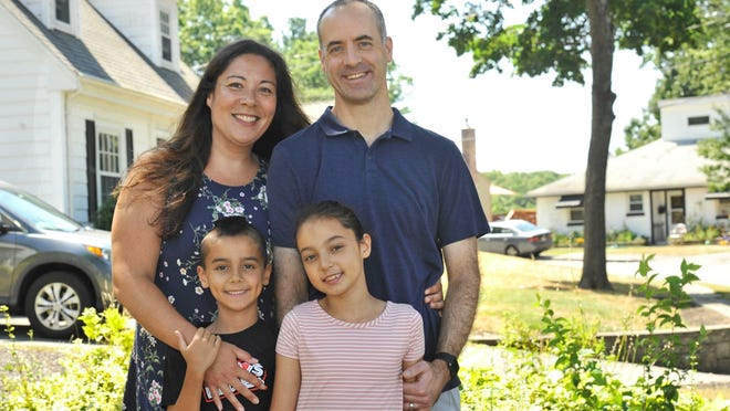 Malissa and Dave Northup of Braintree pose with their children, Grady, 7, and Lila, 9, Saturday, Aug. 8, 2020. Tom Gorman/For The Patriot Ledger