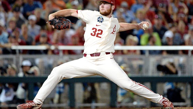 Matt Cronin pitches against Oregon State in the College World Series in June 2018. He was moved up from Single A baseball to the Washington Nationals roster last week.