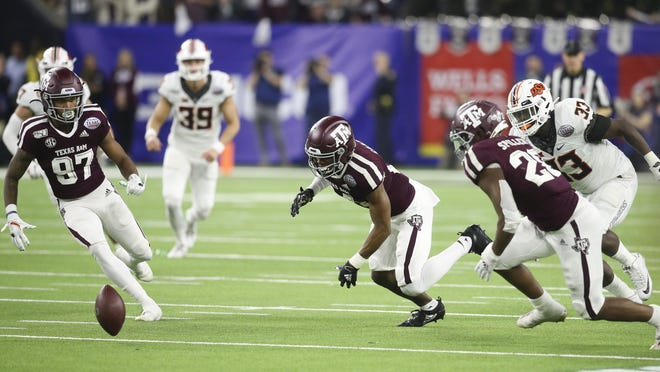 Texas A&M players recover an onside kick against Oklahoma State in the 2019 Texas Bowl. SEC officials announced Friday that players will undergo COVID-19 tests at least twice during game weeks this season.