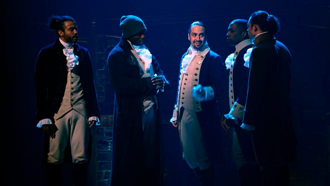 "In this image released by Disney Plus, from left, Daveed Diggs, Okieriete Onaodowan, Lin-Manuel Miranda, Leslie Odom Jr. and Anthony Ramos appear in a filmed version of the original Broadway production of ""Hamilton."""