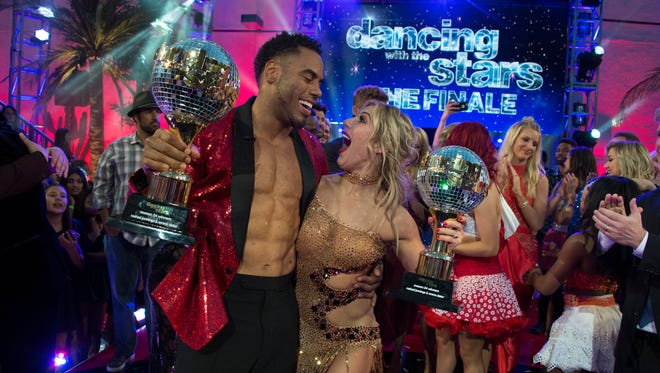 Rashad Jennings and Emma Slater show off their mirror ball trophies after winning ABC's 'Dancing With the Stars.'
