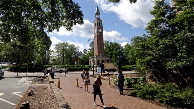 The Bell Tower looms over students on campus at the University of North Carolina.