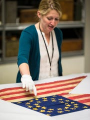 Andrea Hoffman, collections manager of the Wisconsin Veterans Museum, talks about a recently acquired Civil War guidon. The guidon, or flag, from the 2nd Wisconsin Cavalry Regiment, was donated by a great-granddaughter of a soldier from the company who kept it after the war.