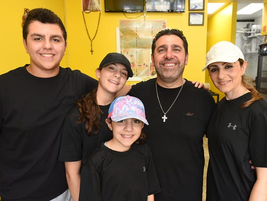 Sonny Nafso and his family at their South Lyon restaurant.