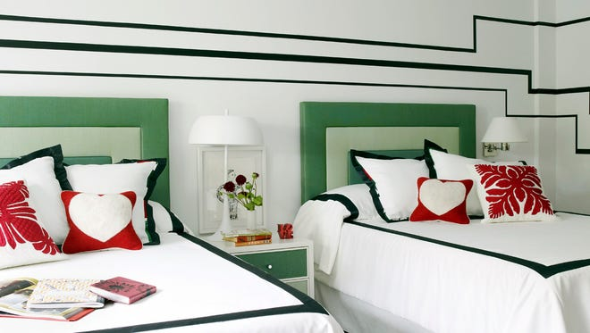 In this undated photo provided by Young Huh, on cold, gray winter days, upholstered headboards like the ones shown in this bedroom designed by Huh offer cheerful color and softness, while also absorbing sound. The quieter the bedroom, says designer Maxwell Ryan, the more welcoming and cozy the space will feel.