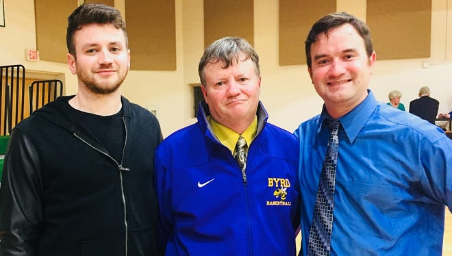 Tyler (left) and Todd (right) celebrated with their father, Byrd coach Rusty Johnson, on his milestone win Tuesday night.