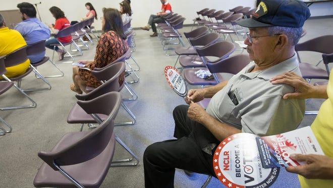 Jimmie Munoz, constable at South Mountain, attends a press conference at South Mountain Community Center in Phoenix on May 14, 2016. Promise Arizona and NCLR are reaching out to Latinos and telling them to make sure to vote throughout the 2016 election cycle.