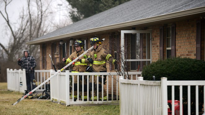 Lancaster firefighters check units in an apartment Wednesday, Feb. 14, 2018, on Glasgow Place in Lancaster. No one was injured in the small fire that flooded one unit with smoke.
