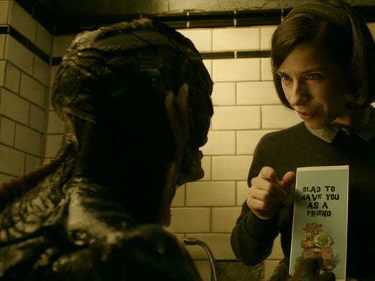 "An amphibious man (Doug Jones, left) befriends a voiceless janitor (Sally Hawkins) in ""The Shape of Water.'"