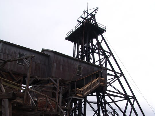 The headframe of the Orphan Girl mine is part of the mining yard available for exploration