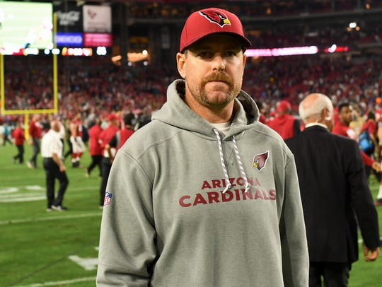 Quarterback Carson Palmer looks on after the Cardinals