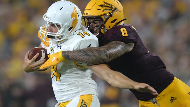 Kent State quarterback Dustin Crum (14) tries to get away from Arizona State linebacker Merlin Robertson during a game at Sun Devil Stadium in August 2019. The Golden Flashes have played three Power Five programs in three of the past four seasons and open their 2021 season at No. 6-ranked Texas A&M on Saturday. (Joe Camporeale-USA TODAY Sports)