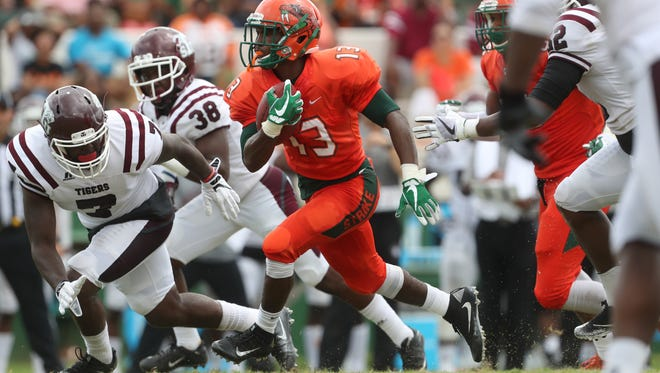 FAMU's Bishop Bonnett runs up the gut of the Texas Southern defense during the Rattler's home opener on Saturday, Aug. 26, 2017.