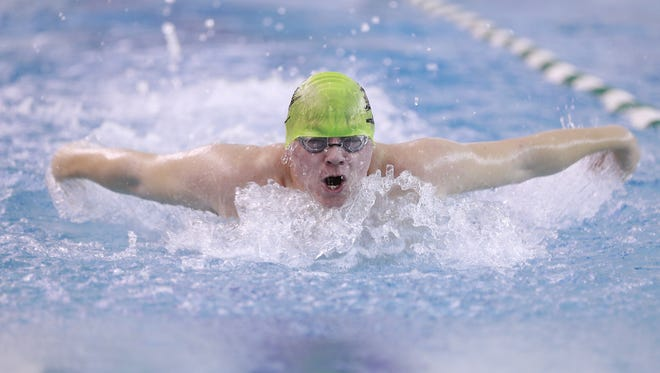 D.C. Everest's Danny Cornish competes in the boys 100 yard butterfly during Thursday's Wisconsin Valley Conference swim meet at D.C. Everest High School