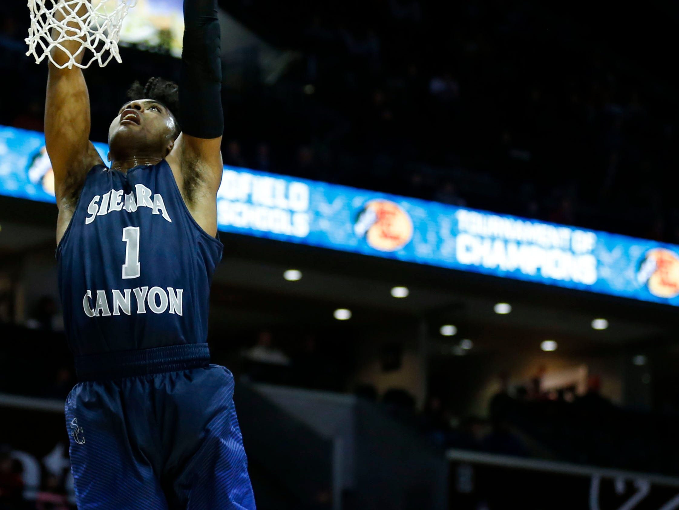 Sierra Canyons Remy Martin dunks the ball as Republics Broc Smith looks on during the first round of the Tournament of Champions at JQH Arena on Thursday, Jan. 12, 2017.