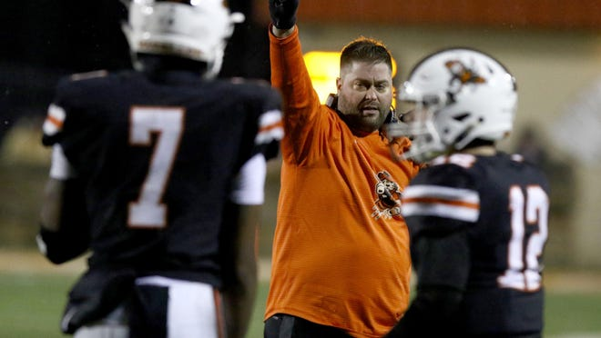 Massillon coach Nate Moore signals for his team to kick the point after touchdown during a 2018 regional-semifinal win over Whitehall-Yearling. Moore, along with now-seniors Jayden Ballard (7) and Zach Catrone (12), began practice on Saturday in advance of their 2020 season opener against Pickerington North.
