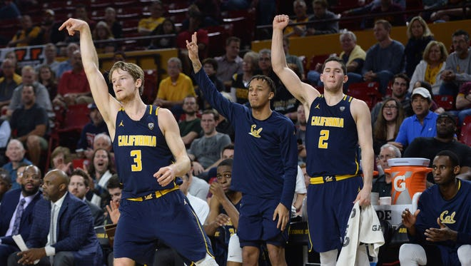 California Golden Bears guard Grant Mullins (3) reacts in front of his bench after making a three point basket against the Arizona State Sun Devils during the second half at Wells-Fargo Arena. The Golden Bears won 68-43, Feb. 8, 2017.