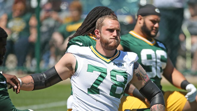 Green Bay Packers offensive guard Jason Spriggs (78) stretches during OTAs on June 6, 2017.