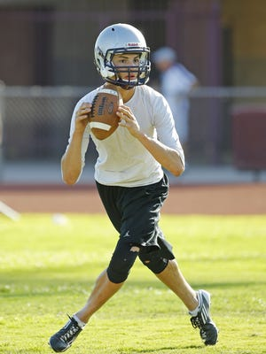 César Chávez High School quarterback Carlos Ritchie during football practice Tuesday, July 26, 2016 in Laveen Village, Ariz.
