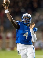 Lanier quarterback James Foster throws a touchdown pass against Russell County in first half action at Cramton Bowl in Montgomery, Ala., on Thursday September 14, 2017.