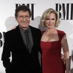Mac Davis and his wife, Lise Kristen Gerard, arrived at the 63rd Annual BMI Country Awards at BMI's Music Row offices on Tuesday.