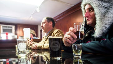 Greg Hillebrand, background, and Don Bouch, right, enjoy samplings of Battlefield Brew Works chocolate bock, Red Circle Ale and pale ale on Friday afternoon April 16, 2016 while visiting Gettysburg's Steinwehr Avenue. The group were the first to patronize the newly opened Battlefield Brew Works tasting room on Steinwehr Avenue.