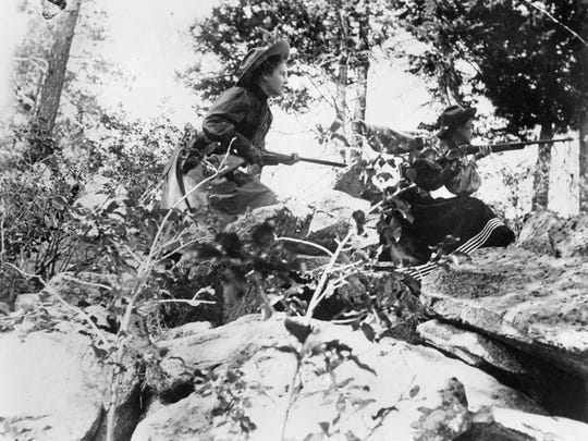 Nancy Russell and she and her husband Charlie's Great Falls friend Josephine Trigg on a hunting trip along the Dearborn River in 1898.