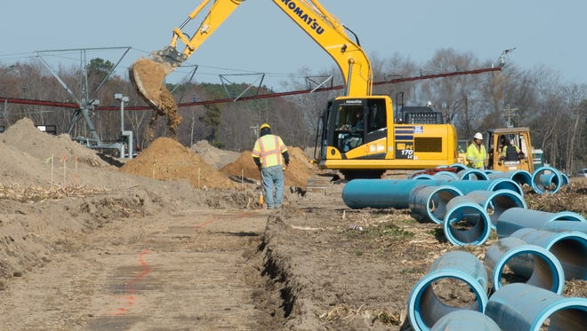 Piping is being laid along Route 30 to transport wastewater from Allen Harim's chicken plant in Harbeson to a 90-million-gallon lagoon located northwest of the town of Milton.