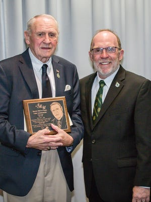 Waynesboro native Cory Hartbarger, left, poses with Northern Michigan University President Fritz Erickson after being inducted into the school's Athletic Hall of Fame in September.