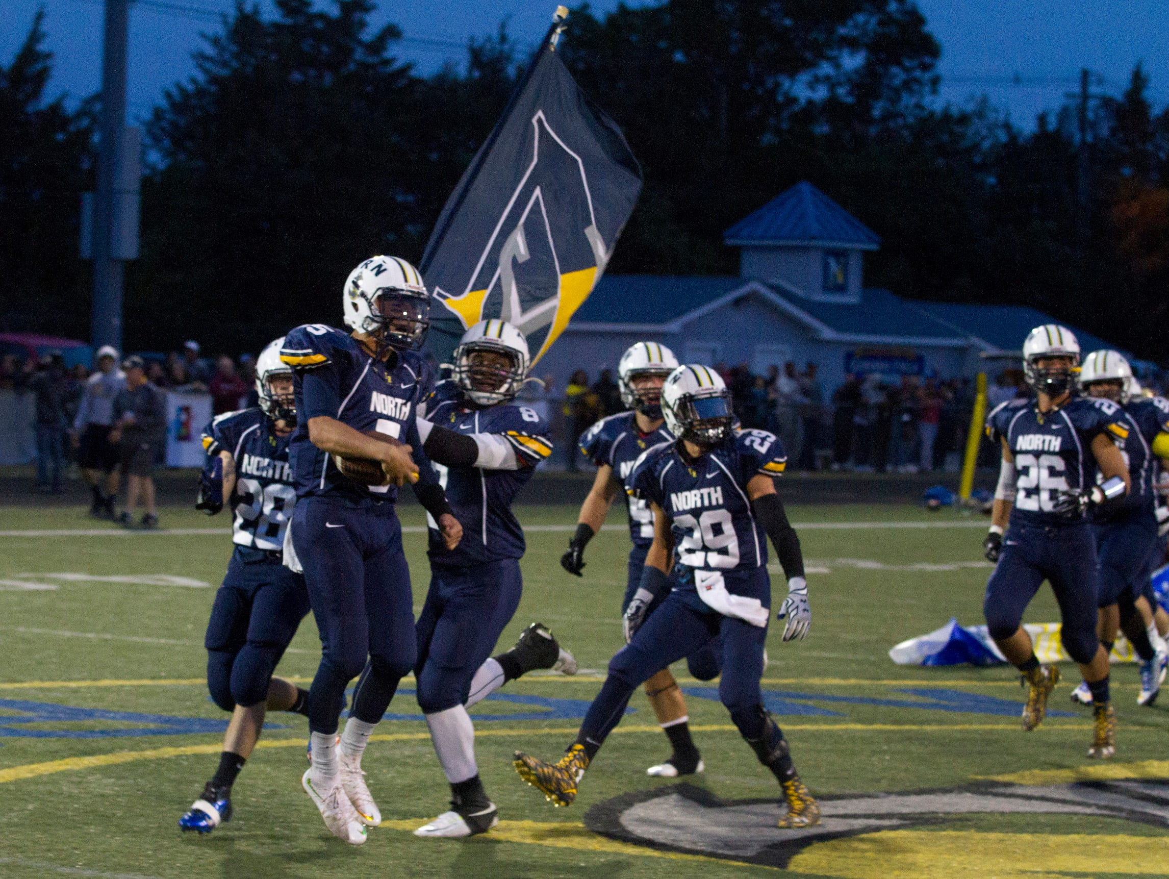 Toms River North heads onto the field for game. Toms River South vs Toms River North Football in Toms River NJ on September 25, 2015.