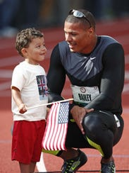 Ryan Bailey celebrates with his son, Tyree during the